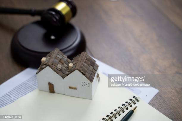 gavel with small house model - legal system stock pictures, royalty-free photos & images