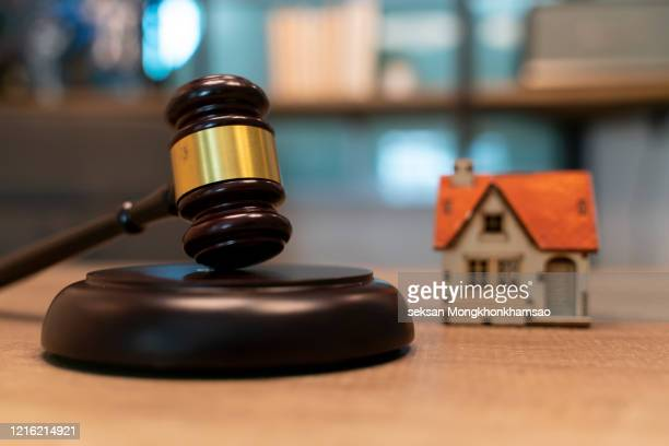 gavel with small house model - bid stock pictures, royalty-free photos & images