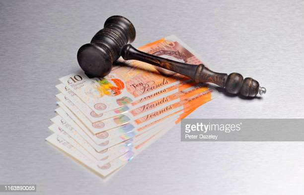 gavel with sterling currency - gavel stock pictures, royalty-free photos & images