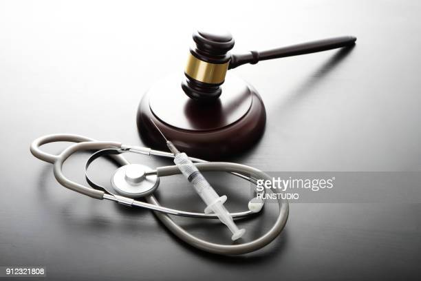 Gavel with Stethoscope and syringe