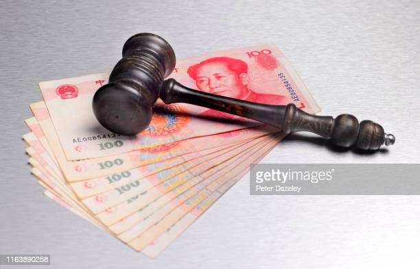 gavel with yuan chinese currency - lawsuit stock pictures, royalty-free photos & images
