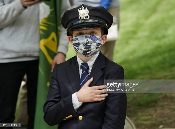 TOPSHOT Gavin age 10 the son of the late Glen Ridge Police officer Charles Rob Roberts looks on during the funeral service of his father who died of...