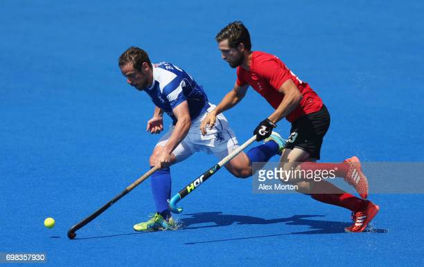 Gavin Byers of Scotland and Iain Smythe of Canada battle for the ball during the Pool B match between Scotland and Canada on day six of the Hero...