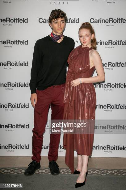 Gavin Casalegno and Larsen Thompson attend the Carine Roitfeld Parfums 7 lovers Cocktail At The Peninsula Hotel In Paris on July 01 2019 in Paris...