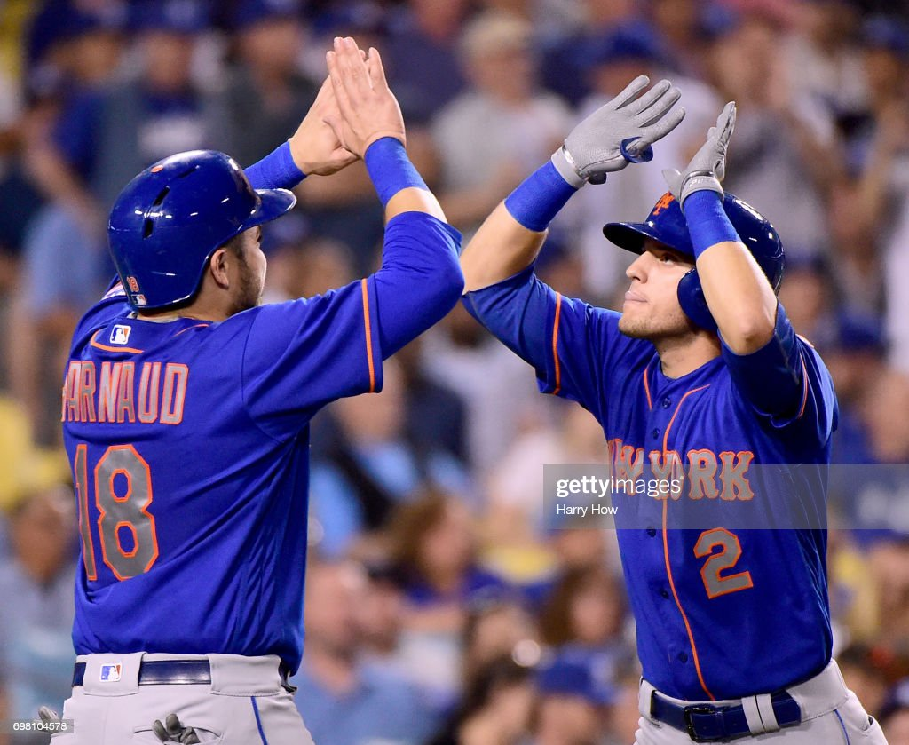 Gavin Cecchini #2 of the New York Mets celebrates his two run homerun with Travis d'Arnaud #18 to trail 7-4 to the Los Angeles Dodgers during the fifth inning at Dodger Stadium on June 19, 2017 in Los Angeles, California.