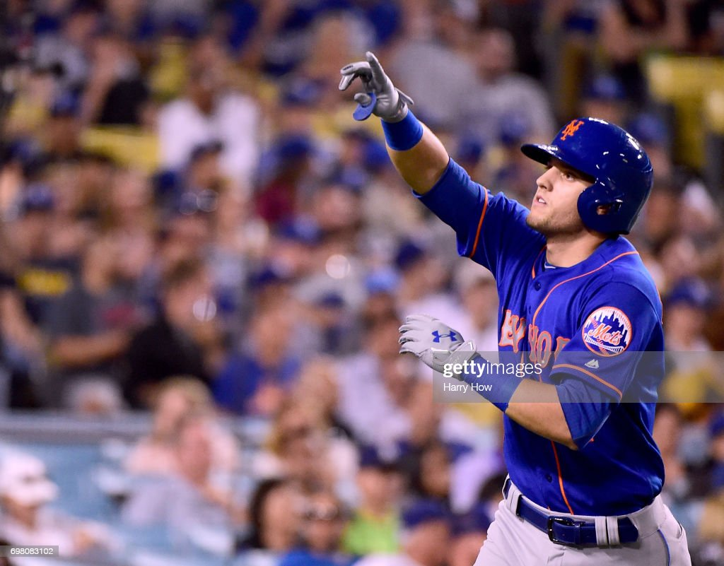 Gavin Cecchini #2 of the New York Mets celebrates his two run homerun to trail 7-4 to the Los Angeles Dodgers during the fifth inning at Dodger Stadium on June 19, 2017 in Los Angeles, California.
