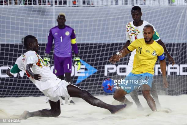 Gavin Christie of Bahamas is challenged by Papa Ndour and Mamadou Sylla of Senegal during the FIFA Beach Soccer World Cup Bahamas 2017 group A match...