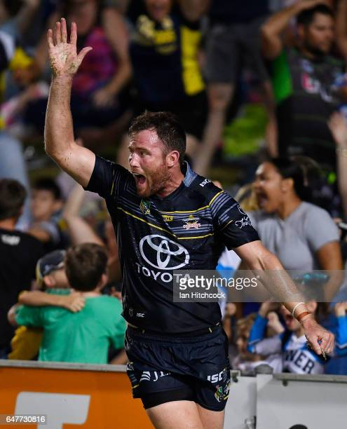 Gavin Cooper of the Cowboys celebrates after scoring the game winning try during the round one NRL match between the North Queensland Cowboys and the...