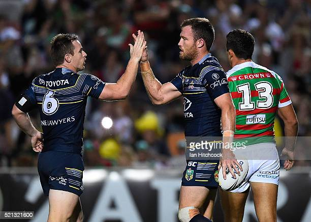 Gavin Cooper of the Cowboys celebrateswith Michael Morgan of the Cowboys after scoring a try during the round seven NRL match between the North...