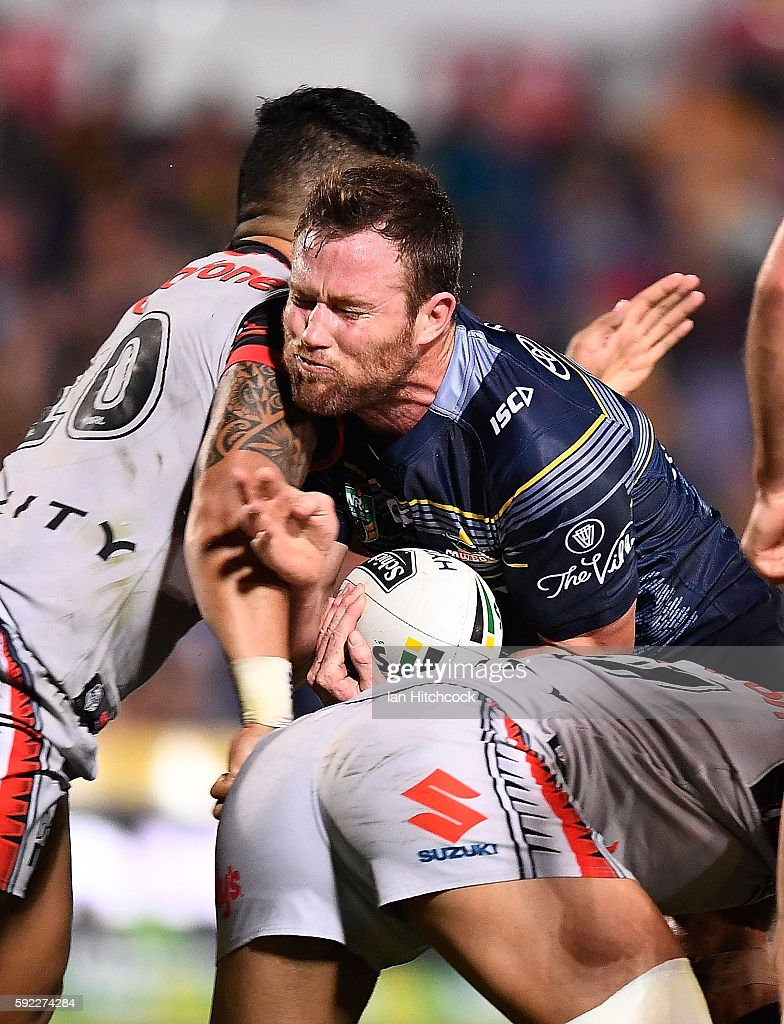 Gavin Cooper of the Cowboys is tackled by Albert Vete of the Warriors during the round 24 NRL match between the North Queensland Cowboys and the New Zealand Warriors at 1300SMILES Stadium on August 20, 2016 in Townsville, Australia.
