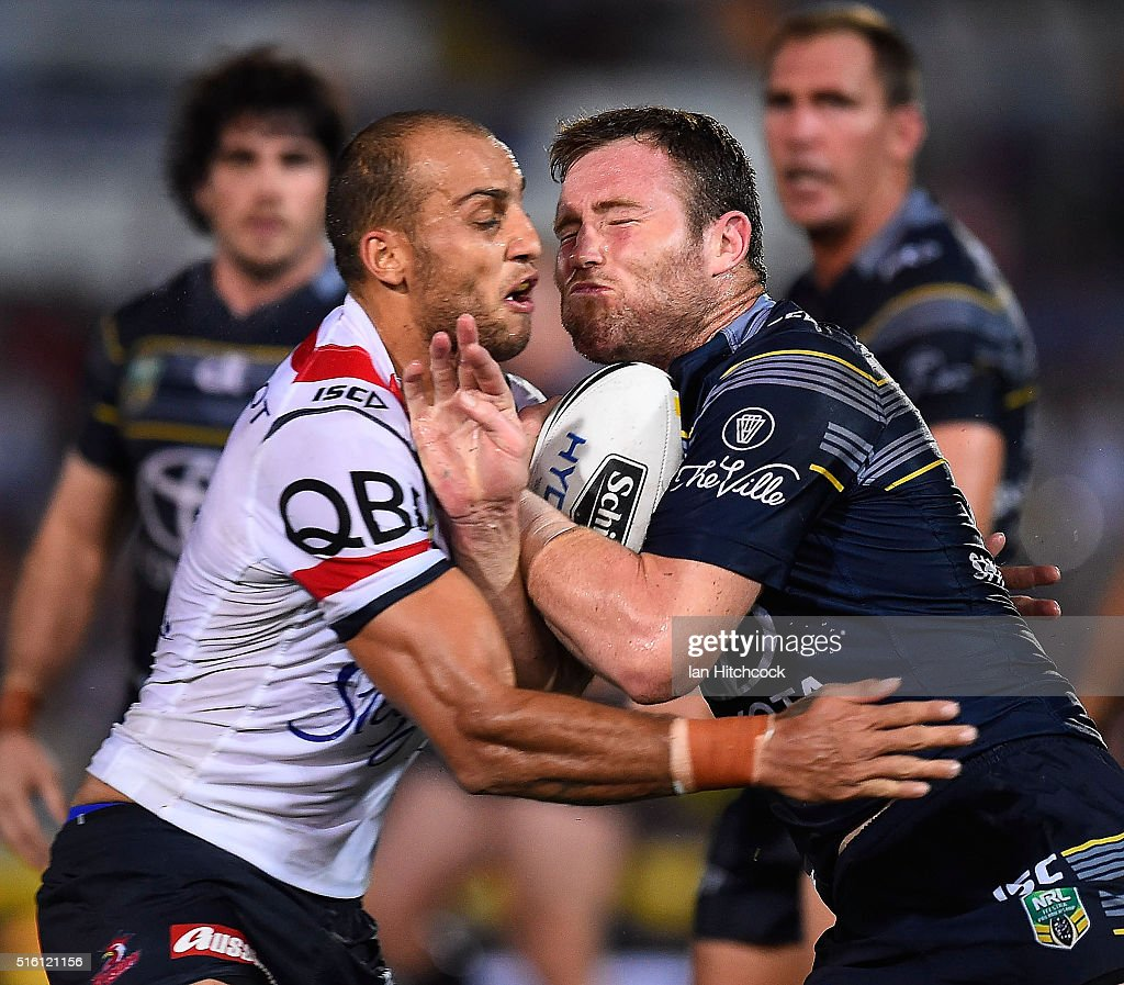 Gavin Cooper of the Cowboys is tackled by Blake Ferguson of the Roosters during the round three NRL match between the North Queensland Cowboys and the Sydney Roosters at 1300SMILES Stadium on March 17, 2016 in Townsville, Australia.