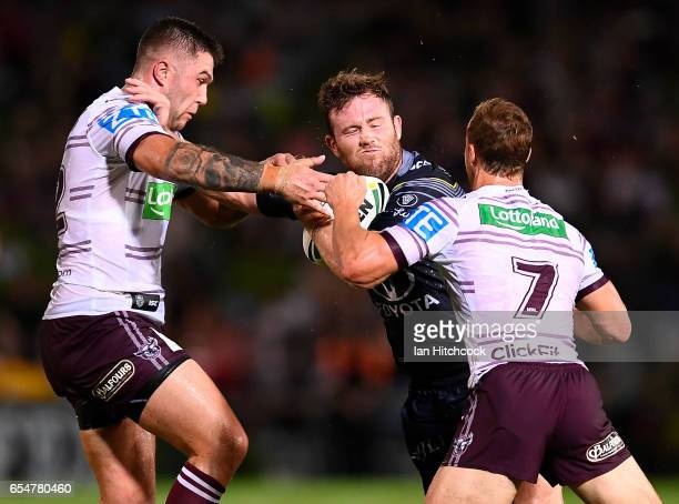 Gavin Cooper of the Cowboys is tackled by Daly CherryEvans and Curtis Sironen of the Sea Eagles during the round three NRL match between the North...