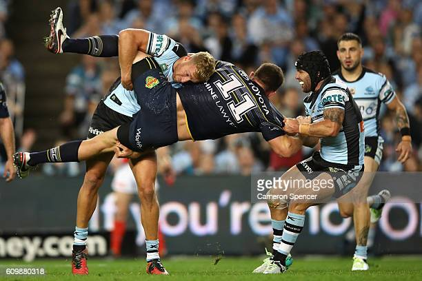 Gavin Cooper of the Cowboys is tackled during the NRL Preliminary Final match between the Cronulla Sharks and the North Queensland Cowboys at Allianz...