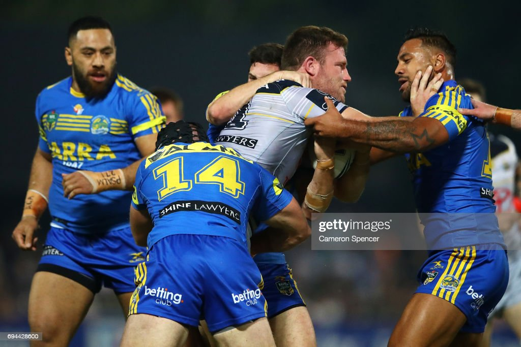 Gavin Cooper of the Cowboys is tackled during the round 14 NRL match between the Parramatta Eels and the North Queensland Cowboys at TIO Stadium on June 10, 2017 in Darwin, Australia.