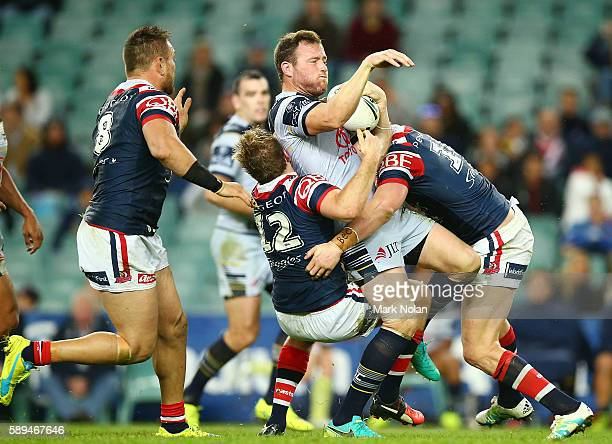 Gavin Cooper of the Cowboys is tackled during the round 23 NRL match between the Sydney Roosters and the North Queensland Cowboys at Allianz Stadium...