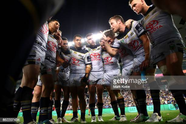 Gavin Cooper of the Cowboys speaks to the his team mates as the Cowboys celebrate victory during the NRL Preliminary Final match between the Sydney...