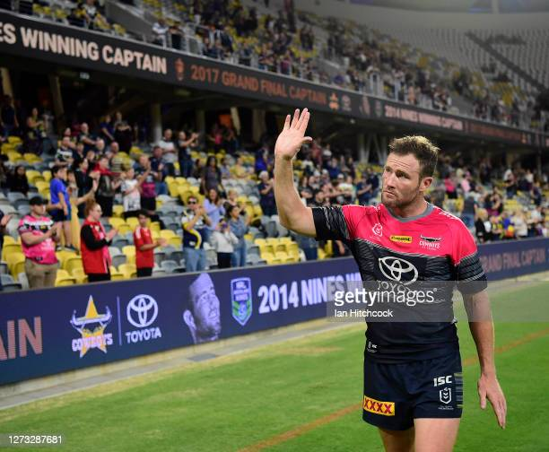 Gavin Cooper of the Cowboys waves to the crow after playing his last home game for the Cowboys at the end of the round 19 NRL match between the North...