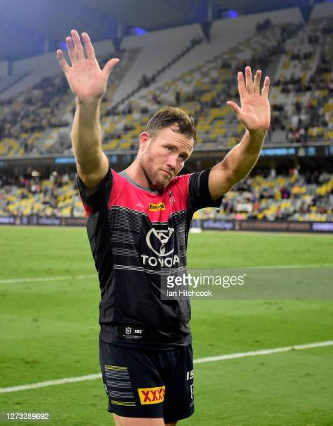 Gavin Cooper of the Cowboys waves to the crowd after playing his last home game for the Cowboys at the end of the round 19 NRL match between the...