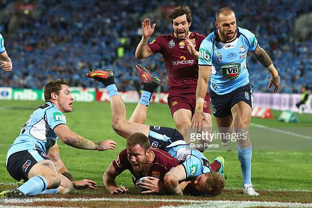 Gavin Cooper of the Maroons scores a try during game three of the State Of Origin series between the New South Wales Blues and the Queensland Maroons...