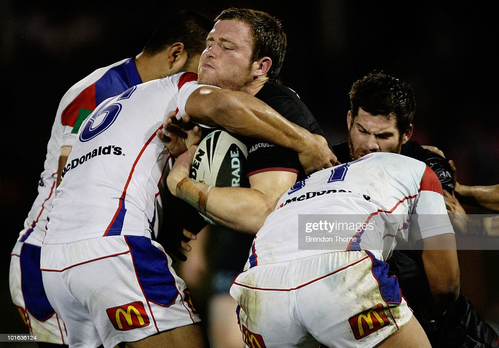 Gavin Cooper of the Panthers is tackled by the Knights defence during the round 13 NRL match between the Penrith Panthers and the Newcastle Knights at CUA Stadium on June 5, 2010 in Sydney, Australia.