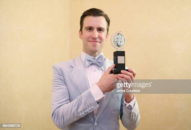 """Gavin Creel, winner of the award for Best Featured Actor in a Musical for """"Hello Dolly!,"""" poses in the press room during the 71st Annual Tony Awards..."""