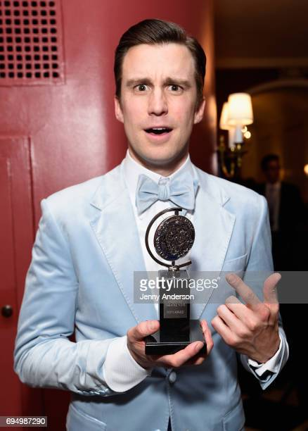 """Gavin Creel, winner of the award for Best Performance by an Actor in a Featured Role in a Musical for """"Hello, Dolly!,"""" poses backstage during the..."""