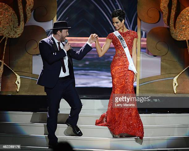 Gavin DeGraw and Miss Jamaica Kaci Fennell onstage during The 63rd Annual Miss Universe Pageant at Florida International University on January 25...