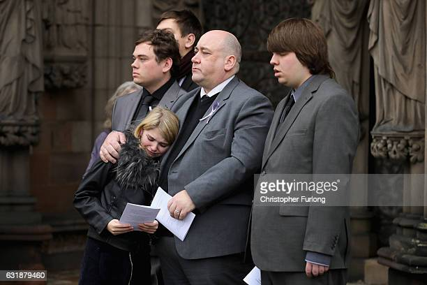 Gavin Drake the husband of Jill Saward embraces his niece Aleasha 13 as he and his sons Fergus Rory and Myles look on as the coffin of Jill Saward...