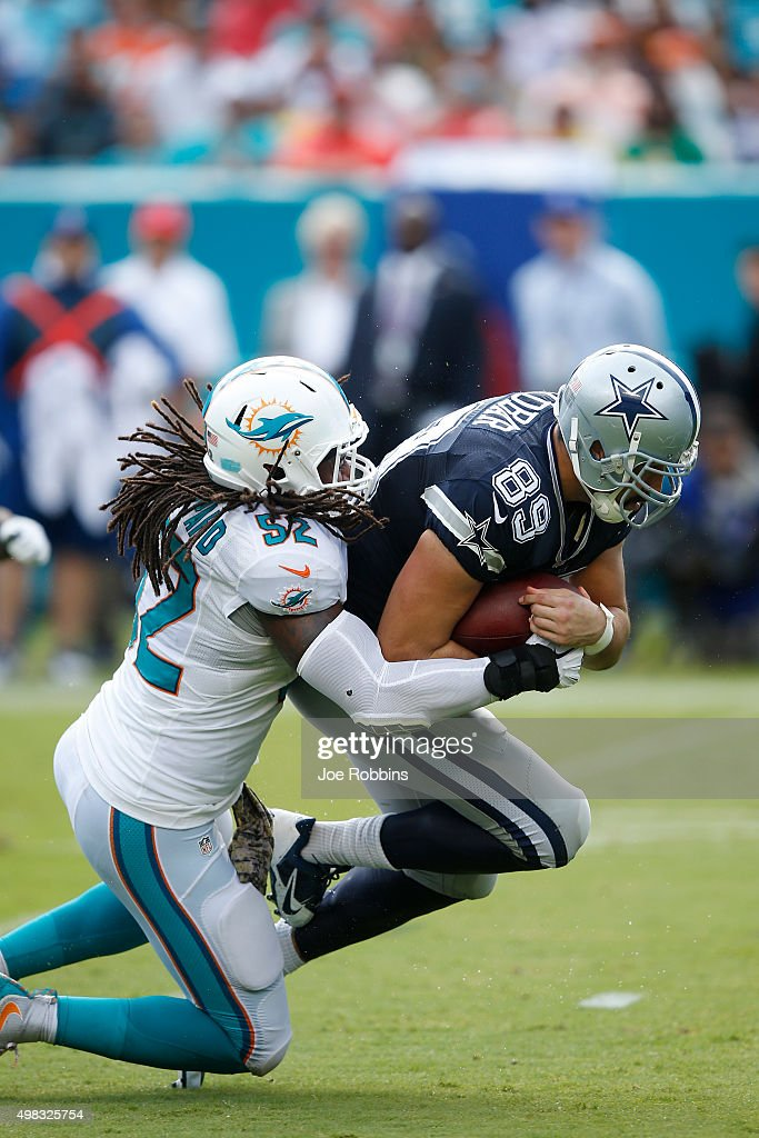 Gavin Escobar #89 of the Dallas Cowboys gets tackled after a reception by Kelvin Sheppard #52 of the Miami Dolphins during the game at Sun Life Stadium on November 22, 2015 in Miami Gardens, Florida. Dallas defeated Miami 24-14.