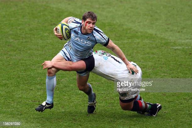 Gavin Evans of Cardiff is tackled by Nic Mayhew of Quins during the LV= Cup match between Cardiff Blues and Harlequins at the Cardiff City Stadium on...