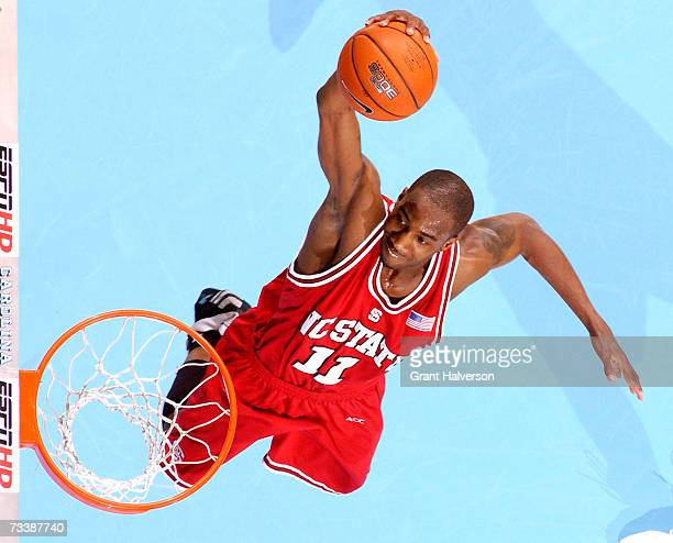 Gavin Grant of the North Carolina State Wolfpack dunks against the North Carolina Tar Heels on February 21 2007 at the Dean Smith Center in Chapel...