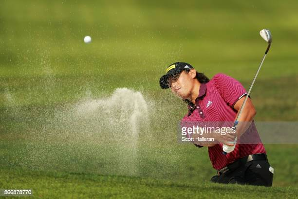Gavin Green of Malaysia plays a shot from a bunker on the 13th hole during the second round of the WGC - HSBC Champions at Sheshan International Golf...