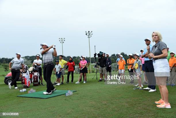 Gavin Green of Team Asia plays a shot during the junior golf clinic after the foursomes matches on day two of the 2018 EurAsia Cup presented by...