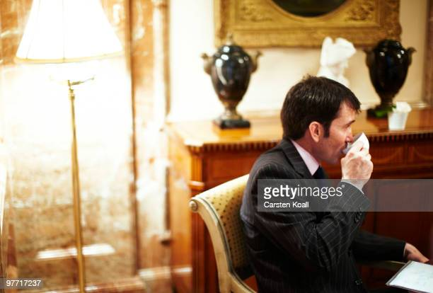 Gavin Halliday, Area General Manager Europe for British Airways , holds a cup of coffee during an interview on March 12, 2010 in Berlin, Germany.