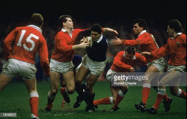 Gavin Hastings of Scotland is surrounded by the Welsh defence during the Five Nations Championship match at Cardiff Arms Park in Cardiff, Wales....