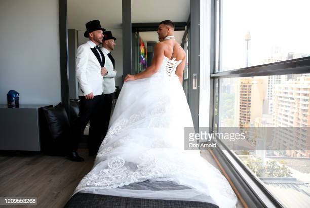 Gavin Haughain and partner Aiden Eric apply finishing touches in an Oxford St apartment just prior to the 2020 Sydney Gay Lesbian Mardi Gras Parade...