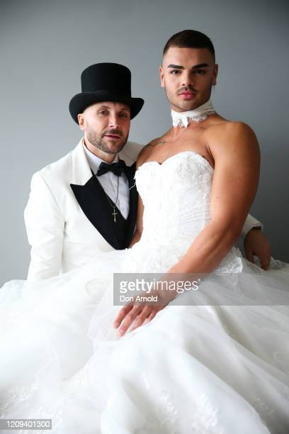 Gavin Haughain and partner Aiden Eric pose inside a friends apartment in the Monument building on February 29 2020 in Sydney Australia Gavin and...