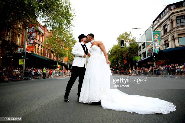 Gavin Haughain and partner Aiden Eric share a kiss in the middle of Oxford St on February 29 2020 in Sydney Australia Gavin and Aiden have stated...