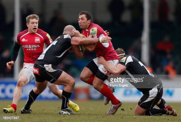 Gavin Henson of London Welsh is tackled by the Exeter defence during the Aviva Premiership match between Exeter Chiefs and London Welsh at Sandy Park...