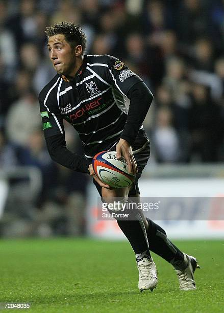 Gavin Henson of the Ospreys starts a move during the EDF Energy Cup match between the Ospreys and Gloucester at the Liberty Stadium on September 29,...