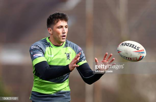 Gavin Henson of West Wales Raiders looks to gather the ball during the Betfred Challenge Cup match between West Wales Raiders and Widnes Vikings at...