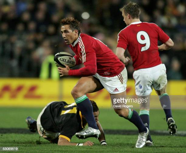 Gavin Henson the Lions centre moves past Roy Kinikinilau during the match between the British and Irish Lions and Wellington at The Westpac Stadium...