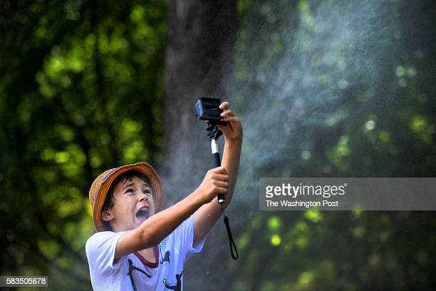 Gavin Jackson Waldman of Sacramento takes a selfie to send to his father later as temperatures reach the mid90's with the heat index of 108 degrees...