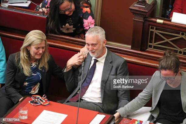 Gavin Jennings MP is congratulated by Harriet Shing MP and Fiona Patten MP as the bill passes inside of the Parliament of Victoria after the Upper...