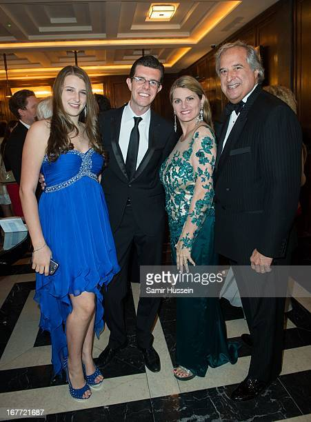 Gavin Lee poses with Top Hat producers Bonnie Comley Stewart F Lane and daughter Leah Lane as they attend a Top Hat Pre Show Party at The Savoy Hotel...