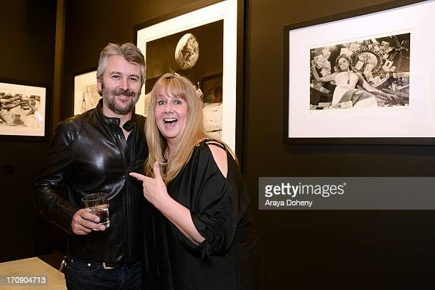 Gavin Lurssen and Marcy Kraft attend a gallery exhibit of Terry O'Neill Presents The Opus A 50 Year Retrospective at Mouche Gallery on June 19 2013...