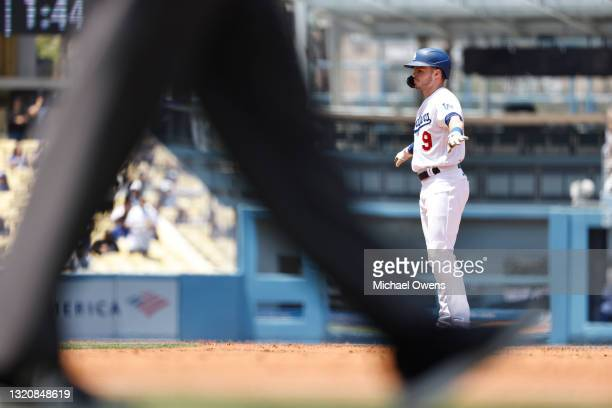 Gavin Lux of the Los Angeles Dodgers reacts after hitting a double against the San Francisco Giants during the second inning at Dodger Stadium on May...