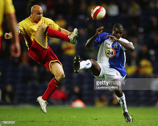 Gavin Mahon of Watford battles with Aaron Mokoena of Blackburn during the Barclays Premiership match between Blackburn Rovers and Watford at Ewood...