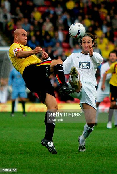 Gavin Mahon of Watford battles with Shaun Derry of Leeds United during the CocaCola Championship match between Watford and Leeds United at Vicarage...