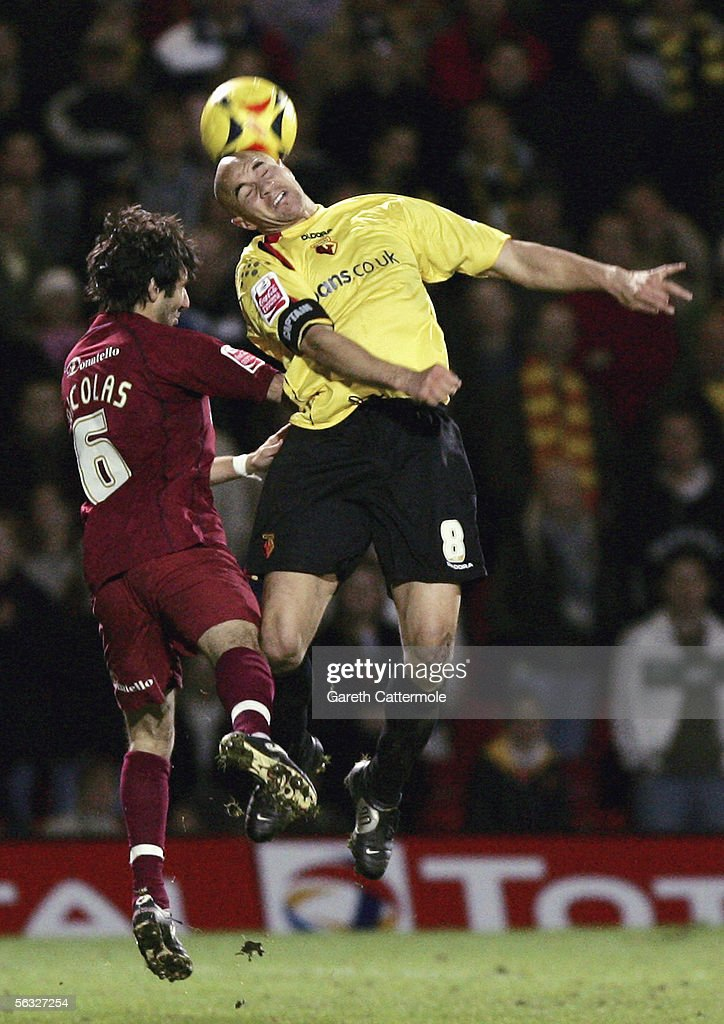 Gavin Mahon of Watford fights for the ball with Alex Nicolas of Brighton & Hove Albion during the Coca-Cola Championship match between Watford and Brighton & Hove Albion at Vicarage Road on December 3, 2005 in Watford, England.
